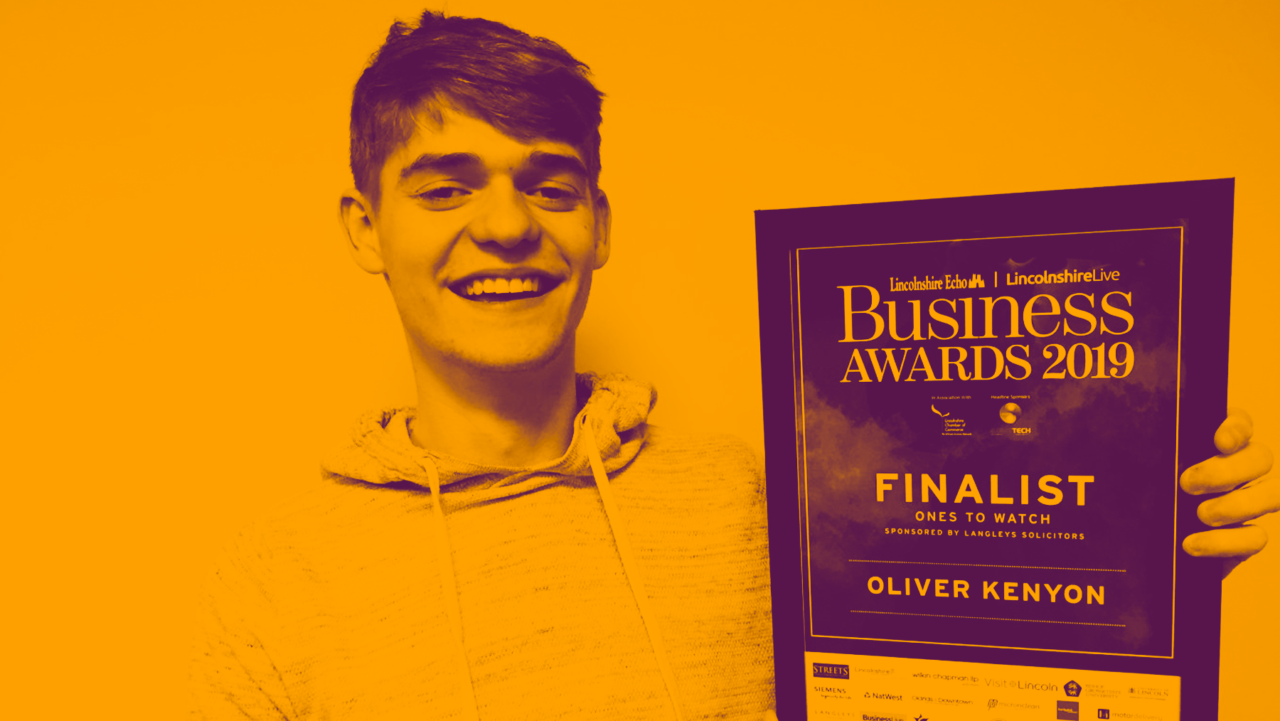 Olly with Business Awards Finalist award