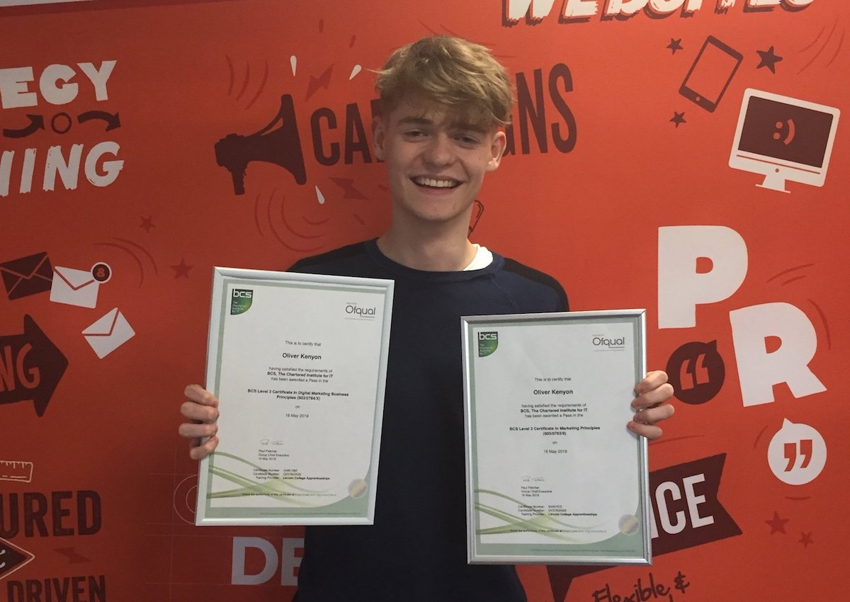 Olly with certificates supporting his Apprenticeship